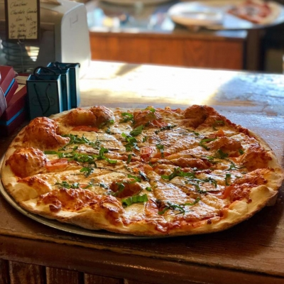 A pie fresh from the brown Jug indoor pizza oven.