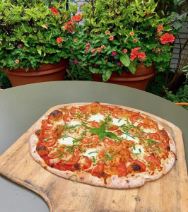 A brown Jug pizza fresh from the oven.
